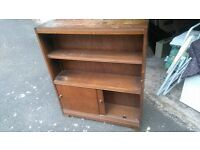 vintage book shelf with sliding doors