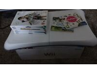 Nintendo Wii with Wii Fit board and games