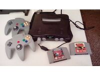 Nintendo 64, two controllers, pokemon snap & pokemon stadium - good condition. Can post or deliver!