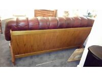 Hand carved oxblood leather three seater settee