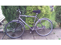 GENTS HYBRID BIKE RALEIGH P1000 , £60.00 ono OR EXCHANGE FOR SIMILAR BUT SMALLER