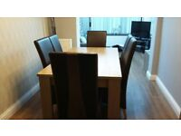 excellent condition dining table and 6 chairs-
