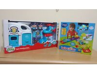 Two brand new Toys-- Vtech toot toot + Grom Play hero heaqquarters
