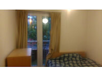 Single queen size bed bedroom with spacious living and dining room at Tytler Court, Edinburgh