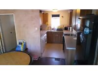Large two bed house with garage in Raynes park wanting a two bed house in