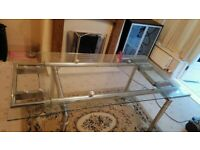 Glass Table with chrome Legs.