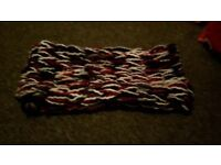Handmade arm knitted scarves.