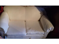 White settee for free loking for a new owner! two seats and one reclinable armchair