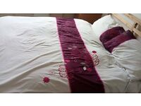 Double duvet and pillow case covers, embroilered flower detail in pink, OK condition.