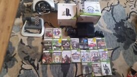 XBOX 360 E Console 500GB + 2 steering weels+2 controllers+lots of games