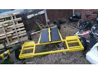 fixed towing dolly will carry from a mini too a jeep comes with ramps