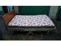 Metal framed fold out double bed.