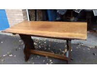 solid oak dining table,length 135cm,width 70cm,made in England,no chairs