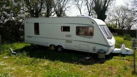 Abbey Spectrum 535 2004 4 berth fixed island bed with centre separate shower and toilet