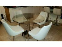 Round glass dining table witg 4 cream faux leathee chairs with chrome legs