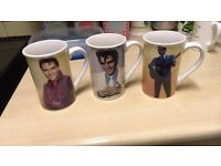 2 sets of Elvis mugs