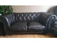 2 X Black leather 2 seater sofas settees. chesterfields