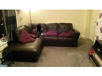 Leather corner settee and storage footstool