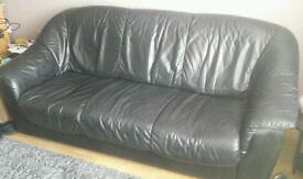 Three seater black leather
