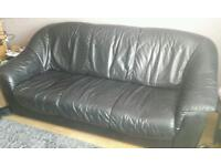 Three seater black leather
