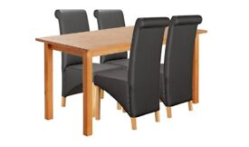 Wooden 150cm tabe and 4 Black Scrollback Deep Skirted Chairs