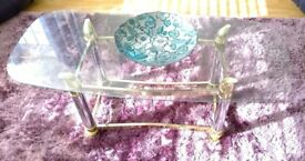 Glass top coffee table and two matching side tables with silver/gold legs and struts.