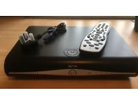 SKY + HD receiver, Sky remote control, and cables.