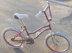"Girls 20"" purple bike"