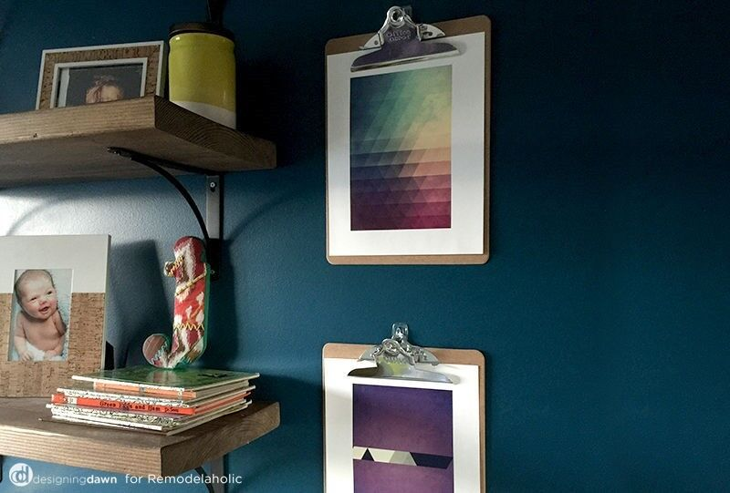 Hanging artwork from clipboards is a simple way to change it out whenever the mood strikes. (Image: Designing Dawn)
