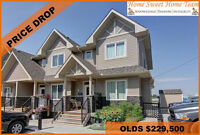 PRICE DROP! AFFORDABLE & CHARMING END UNIT OLDS TOWNHOUSE