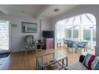 Unique 2 bedrooms holiday apartment on popular Medmerry Park West Sussex 5 minutes to beach.