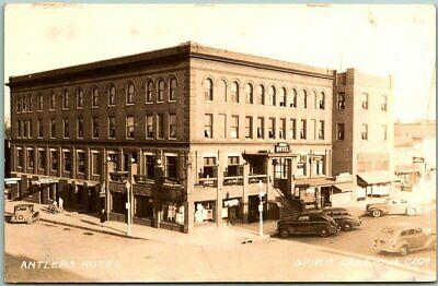 1940s SPIRIT LAKE, Iowa RPPC Real Photo Postcard ANTLERS HOTEL Street Scene