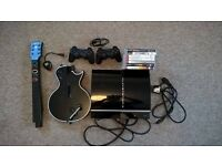 Sony PlayStation 3 PS3 bundle, 2 controllers, guitar plug in, 7 games and all cables