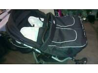 Twins/double pushchair with car seats and accessories