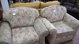 Two floral armchairs