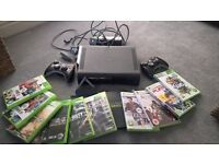 Xbox 360 with 2 controllers and games.