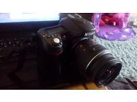 Nikon D80 10.2MP Digital SLR Camera Kit with 18-135mm Zoom Lens and Camera Bag