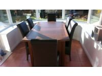 reduced price. Solid wood extending dining table+6 brown leather chairs, Debenhams.