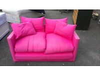 Small pink sofa bed. Good condition.
