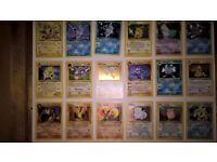 Pokemon trading cards in holder