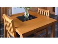 Solid Oak Dining Table which extends, and 4 matching chairs with leather seats