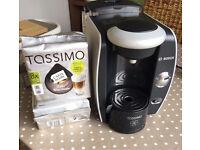 Tassimo coffee machine and 18 latte pods