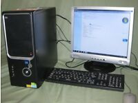 "Desktop Computer with 19"" screen, keyboard and mouse."