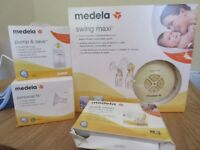 Medela Swing Maxi Double Electric Breast Pump set plus extras.