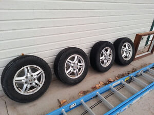 15 in All-Weather tires on aluminum rims. Great for winter! Peterborough Peterborough Area image 1