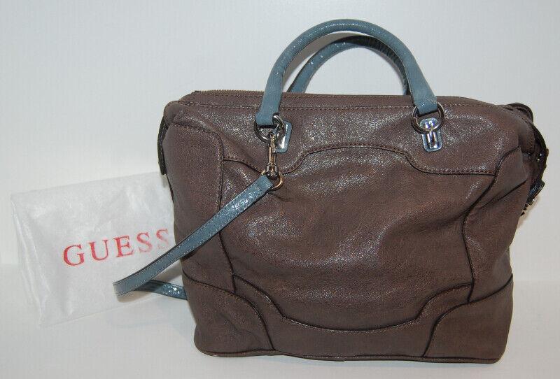 Description. I have for sale a GUESS Brown Monogram handbag with handles  and crossbody shoulder strap. 881b44c371920