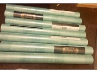 7 rolls of wall paper colour is a turquoise like shade for £14