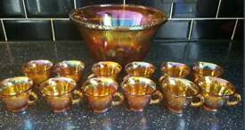 Beautiful vintage orange carnival glass punch bowl and 12 glasses