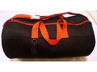 DIESEL black and red duffle bag. Brand new with tags.