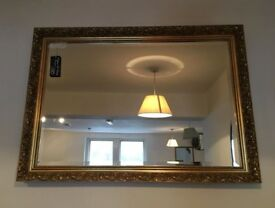 Modern gilt framed wall mirror